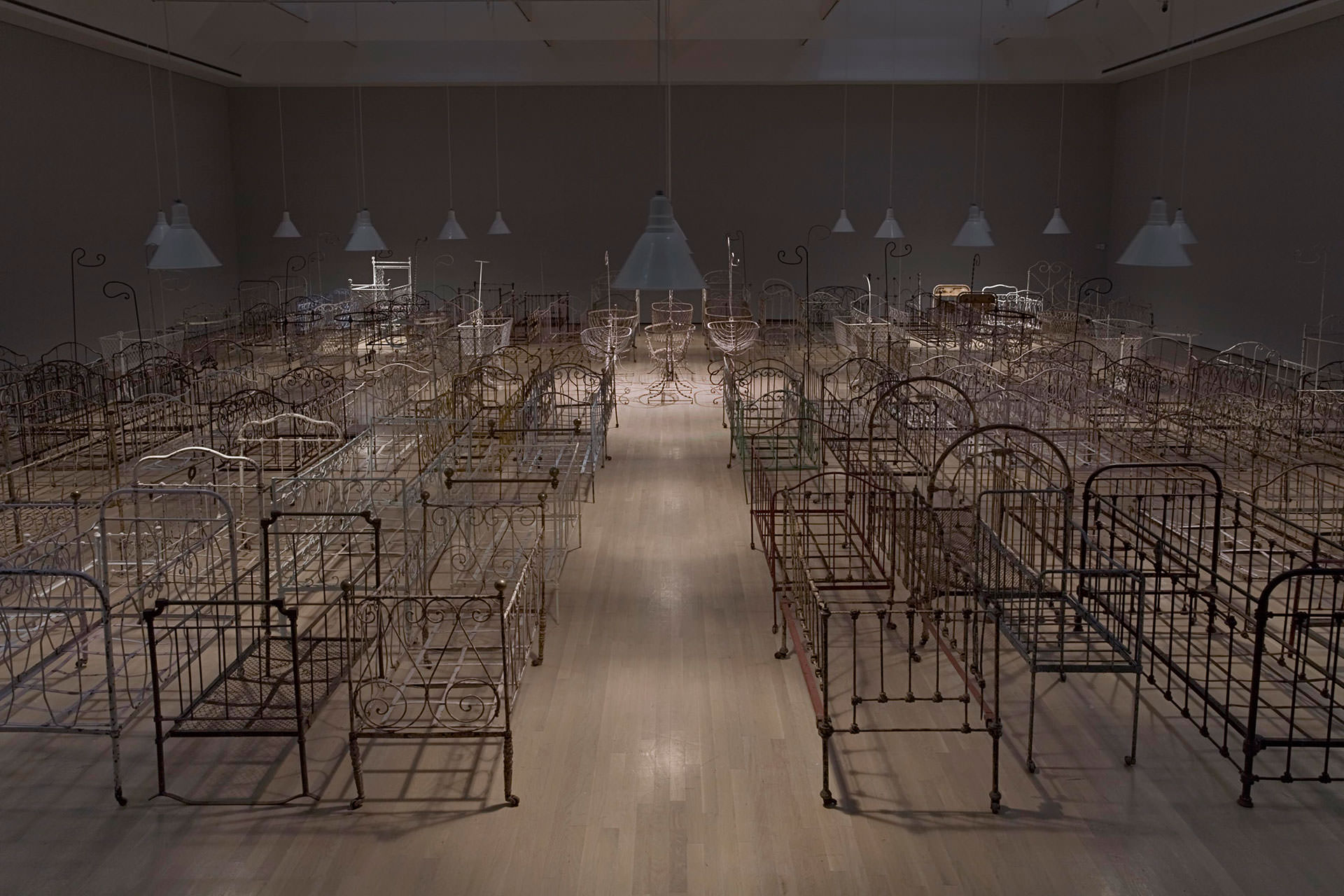 Le Jardin du Sommeil , 2009, 4000 square feet, 140 antique and vintage metal children's beds and cradles, collected in Canada and France. Musee d'art contemporain de Montreal collection