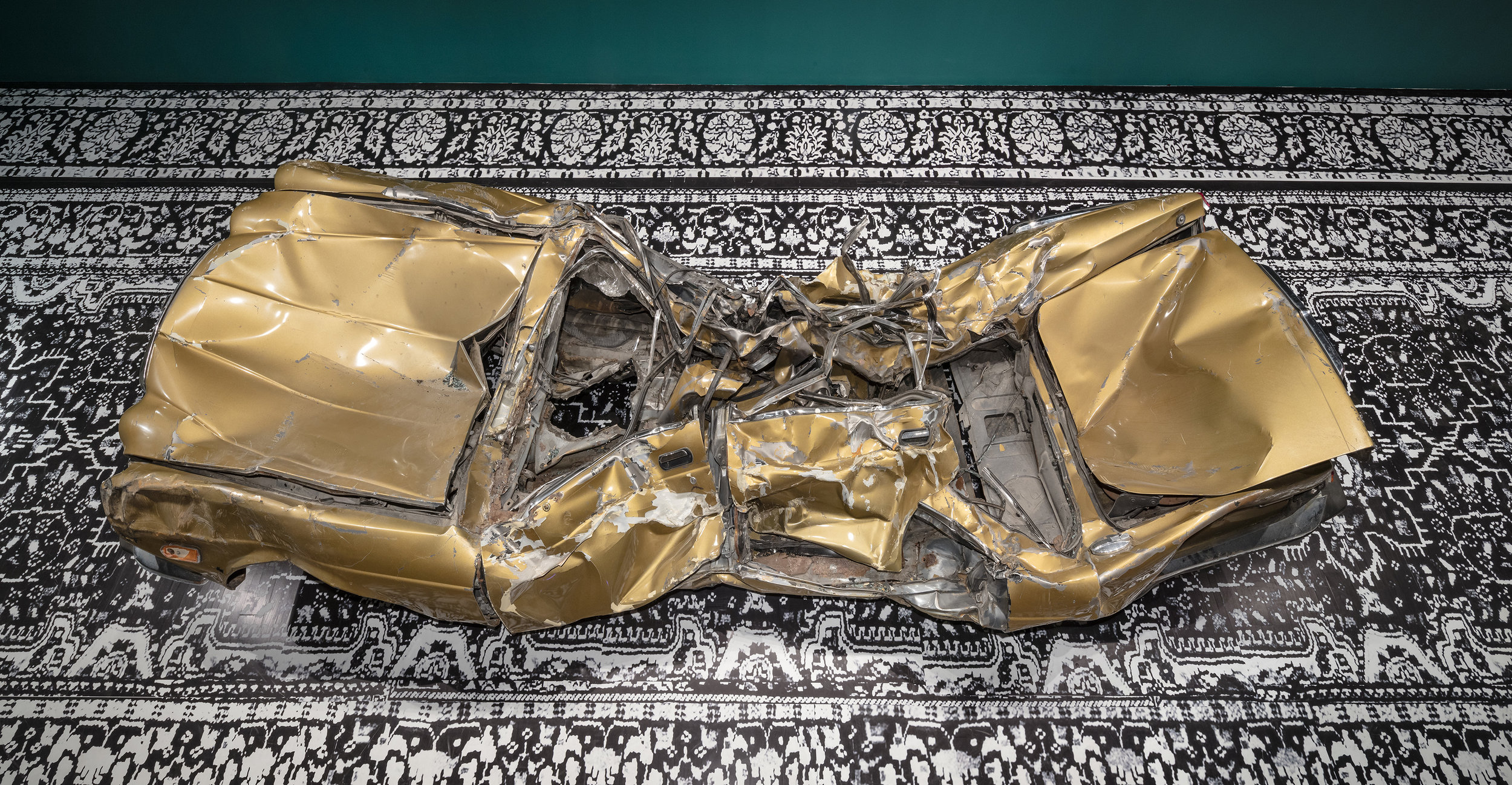 I am the American Dream (still just a Paki)/Seminar Series on Race, Destruction and the many afterlives of a Paki: A private talk for one by your less than Ideal Representative , 2010/17, 1987 gold Jaguar Vanden Plas, installation view at the Art Museum at the University of Toronto as part of the 2017 Sobey Art Award exhibition