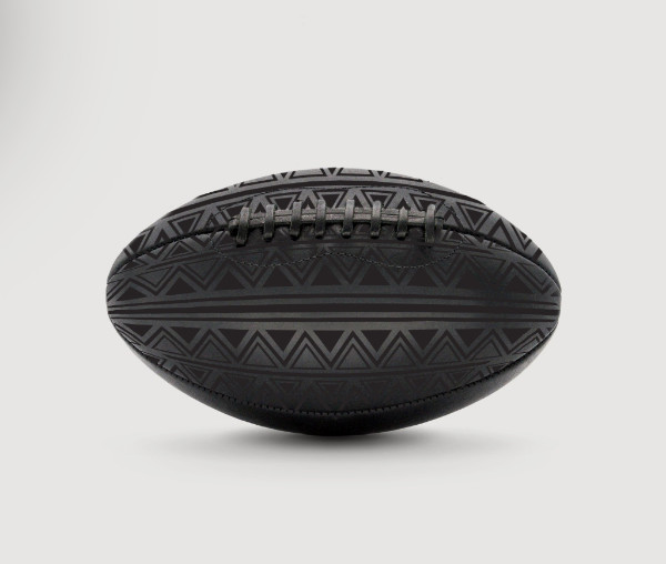 Blood and Tears Instead of Milk and Honey , 2018, installation of 22, custom-made leather footballs, synthetic turf, spray paint, ceramics, edition of 22 (1 AP)