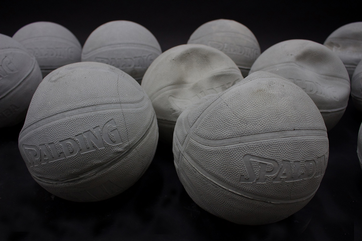 Heavy, Heavy (Hoop Dreams), Detailed view , 2016-17, 60 solid concrete basketballs, 30lbs each, 10x10ft. Image courtesy the Art Gallery of Ontario