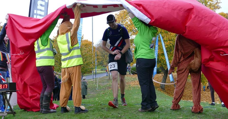 Top team welcoming the runners home under a deflated finish sign