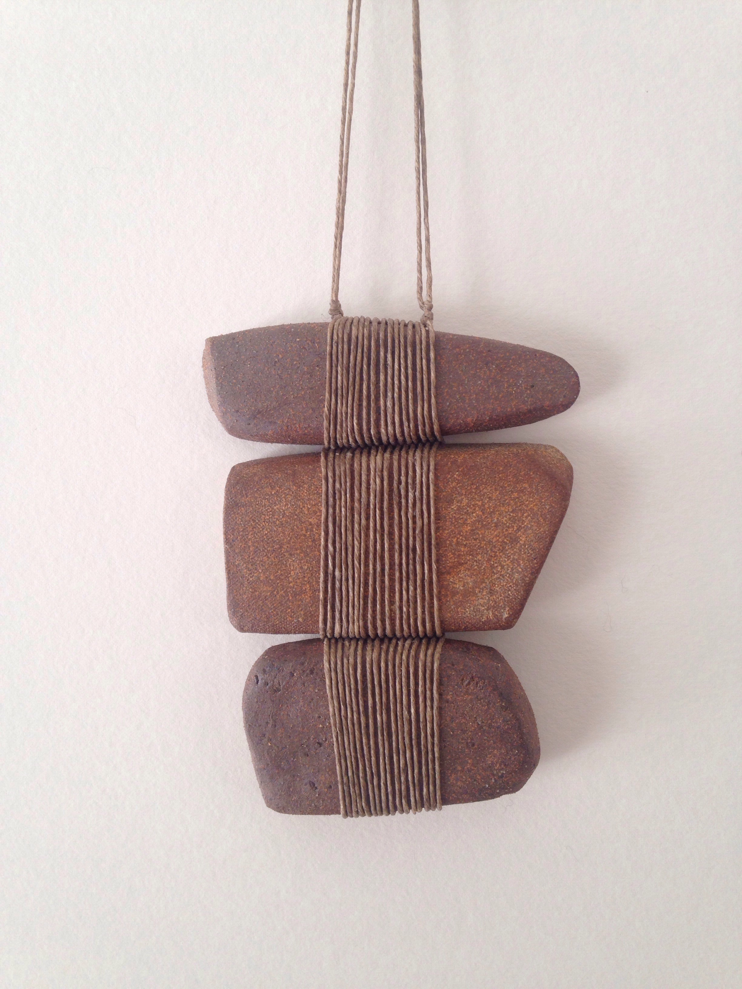 """Stoneware and linen 5 1/2"""" length 4 1/4"""" width"""