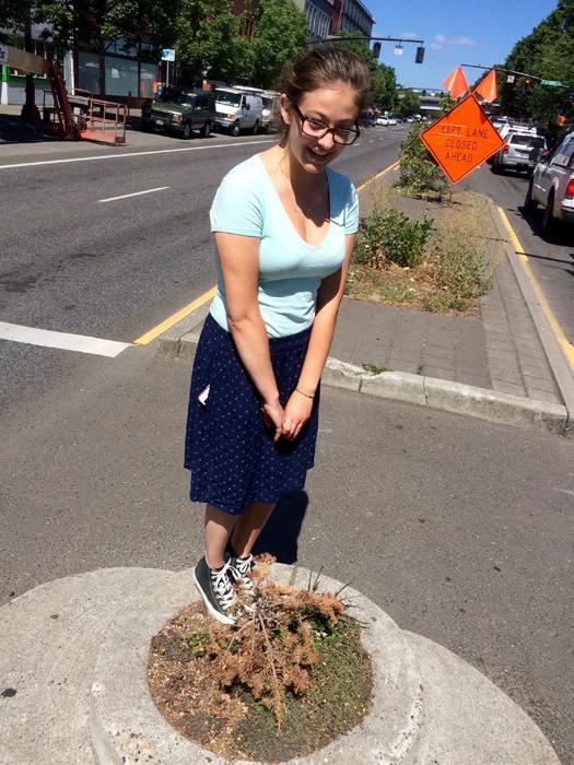 isabelle standing in world's smallest park, portland oregon