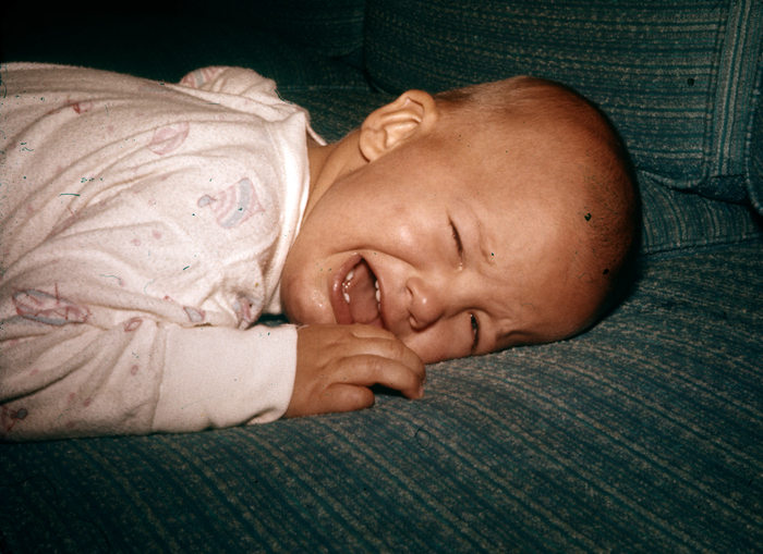Me, baby, crying, on couch_adj01-sm.jpg