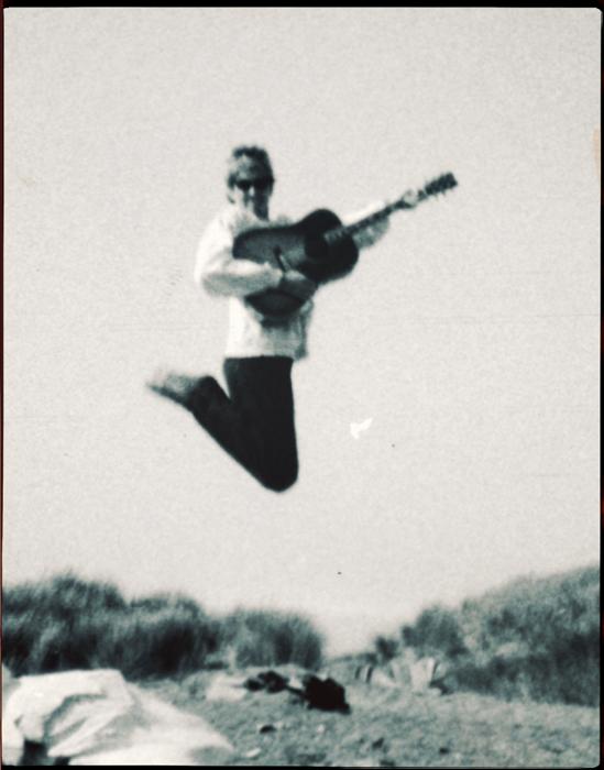 SE-beach-Michael & Deborah-guitar-jumping_adj01b-sm.jpg