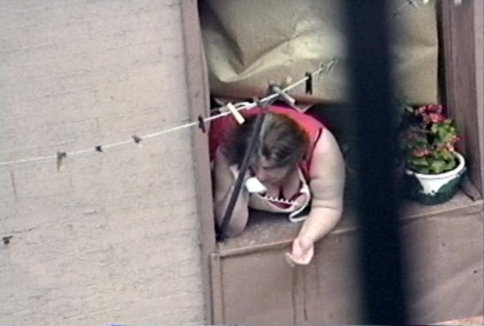 NYC-woman in window on phone_adj01-sm.jpg