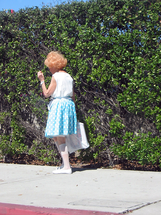 Woman on sidewalk with bag_adj01-sm.jpg