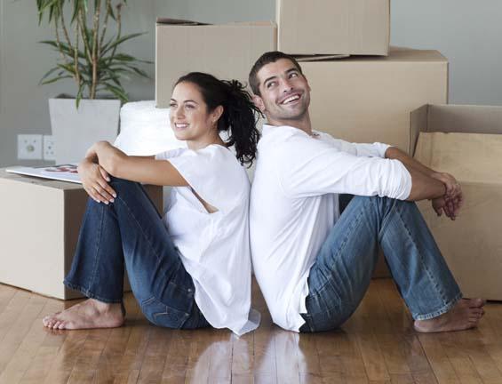 couple among moving boxes.jpg