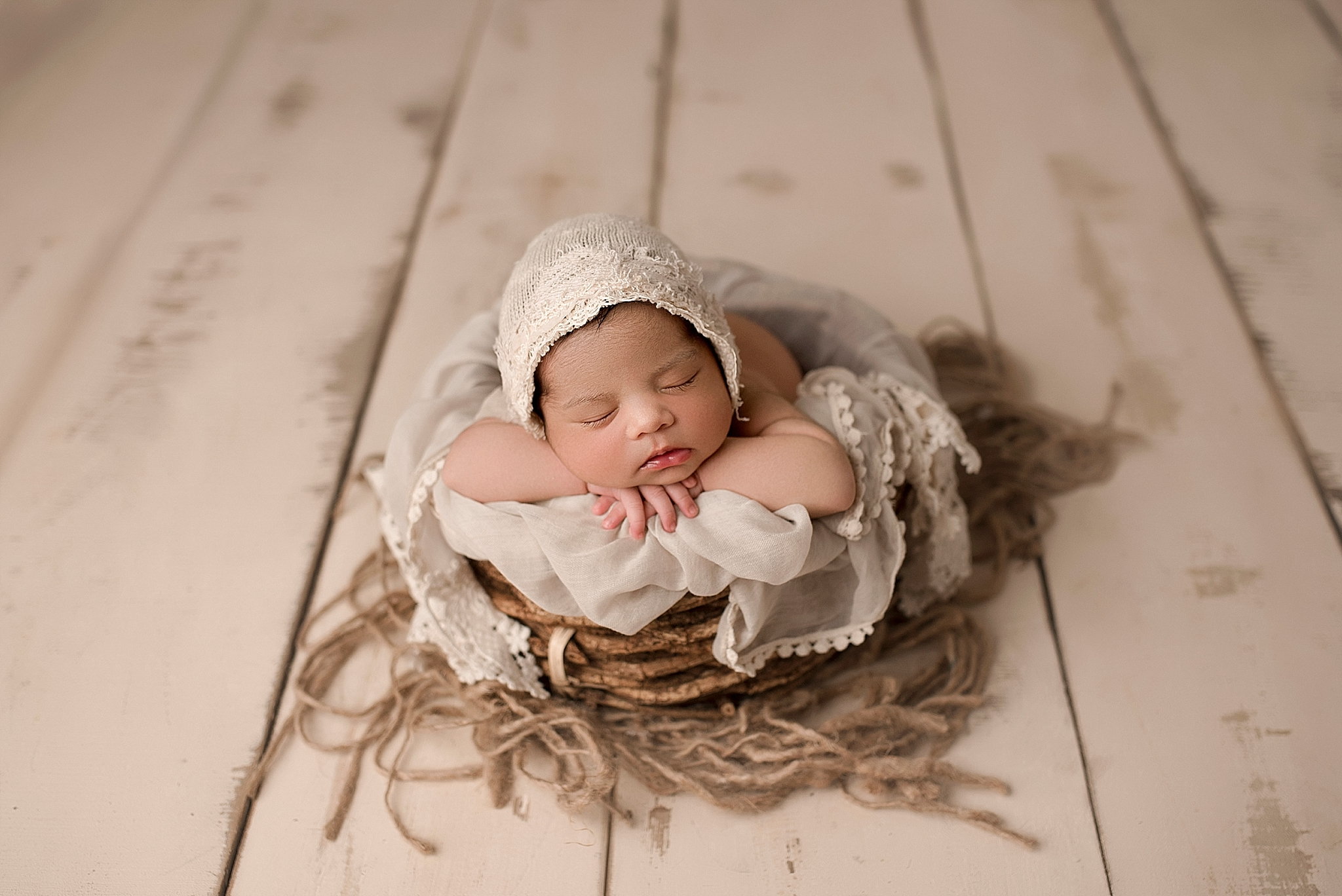 Neutral baby girl newborn photoshoot