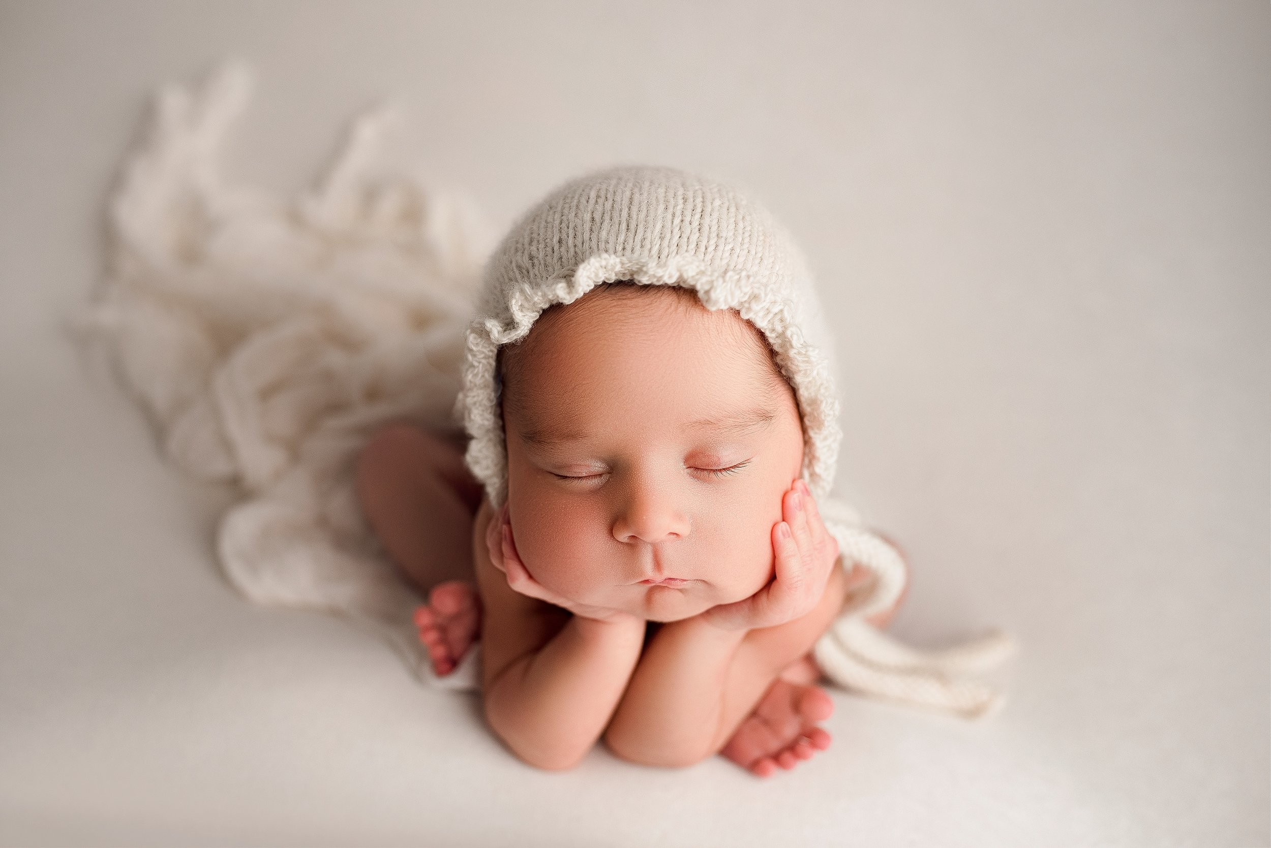 Newborn froggy pose