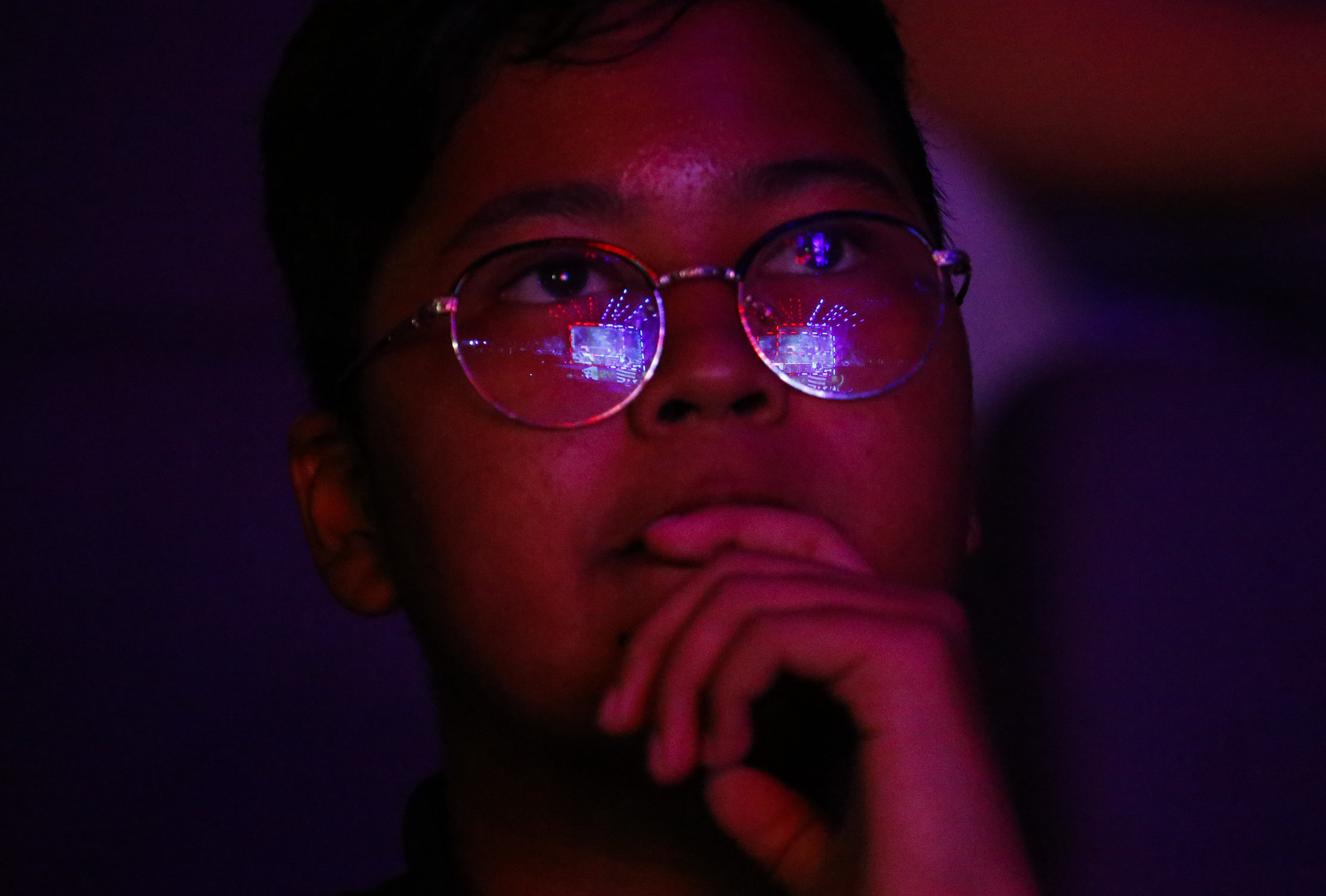 An audience member watches League of Legends players compete at Hyperplay, an e-sports tournament held in Singapore, August 4, 2018. REUTERS/Feline Lim