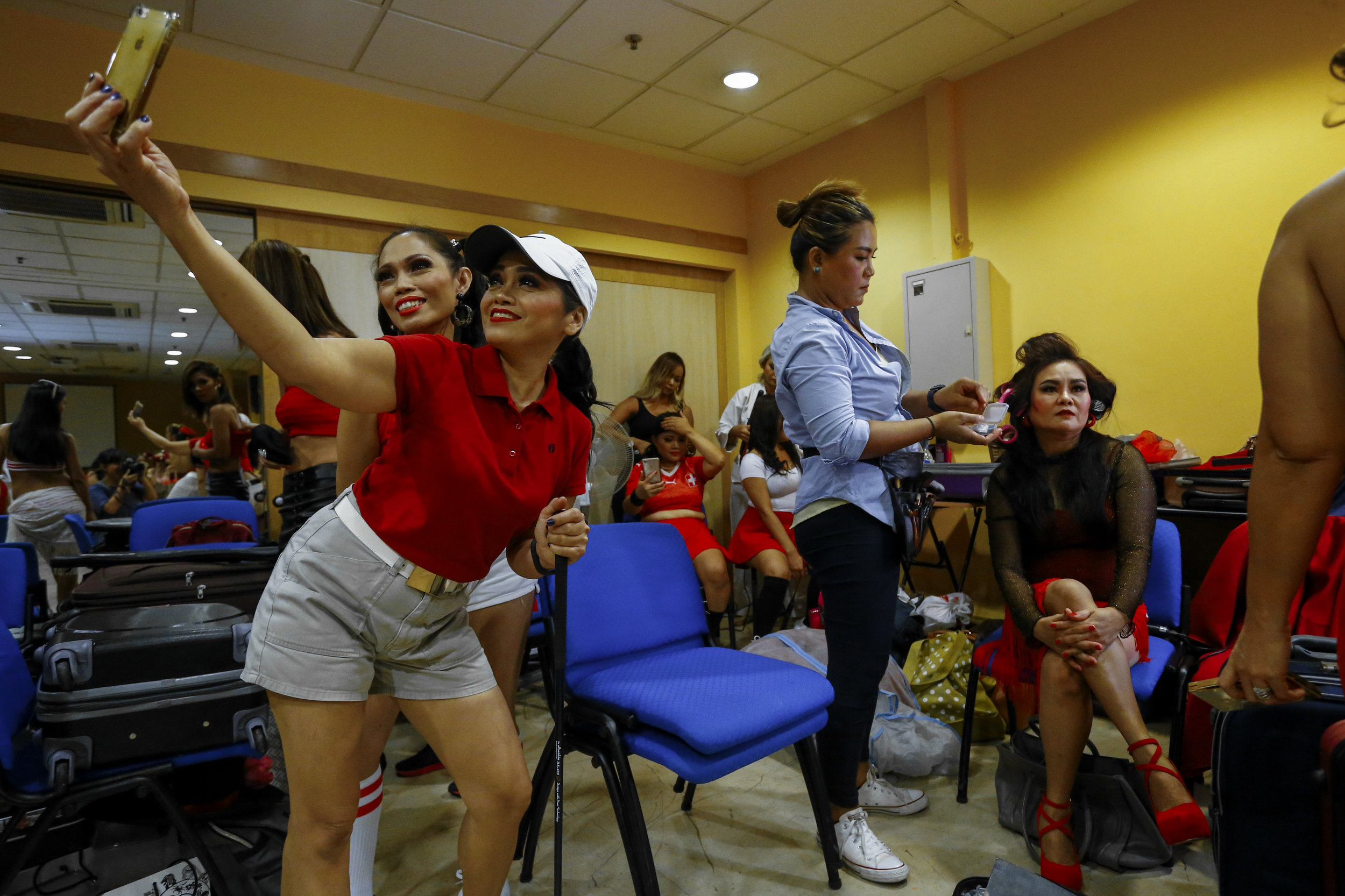 Contestants prepare backstage at Rampstar 2018, a beauty pageant organised largely for Filipino domestic helpers in Singapore, July 29, 2018. REUTERS/Feline Lim