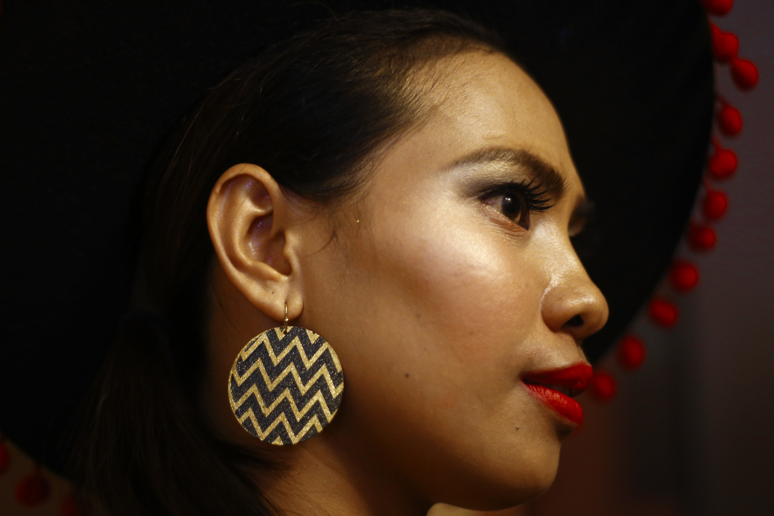 A contestant waits backstage at Rampstar 2018, a beauty pageant organised largely for Filipino domestic helpers in Singapore, July 29, 2018. REUTERS/Feline Lim