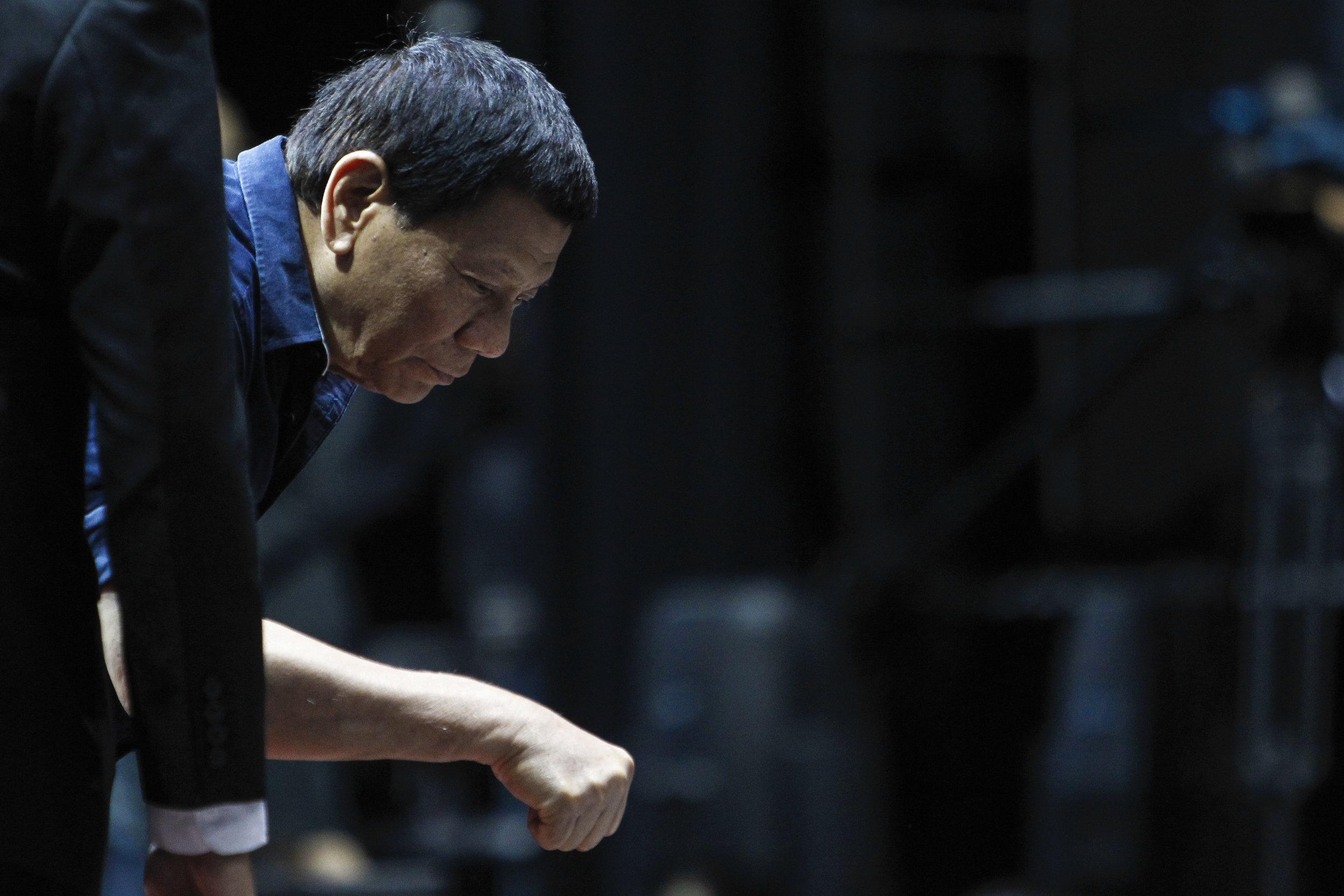 Philippines President Rodrigo Duterte fist bumps a supporter at a community gathering event in Singapore, April 28, 2018. REUTERS/Feline Lim