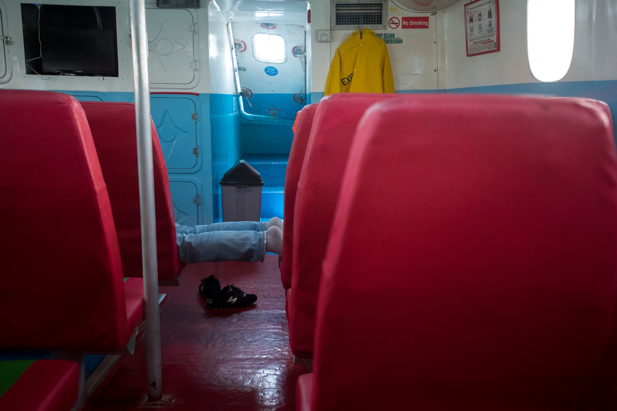 A passenger onboard a ship's tender en route from Tanah Merah Ferry Terminal to M/V Amusement World, March 15, 2018.