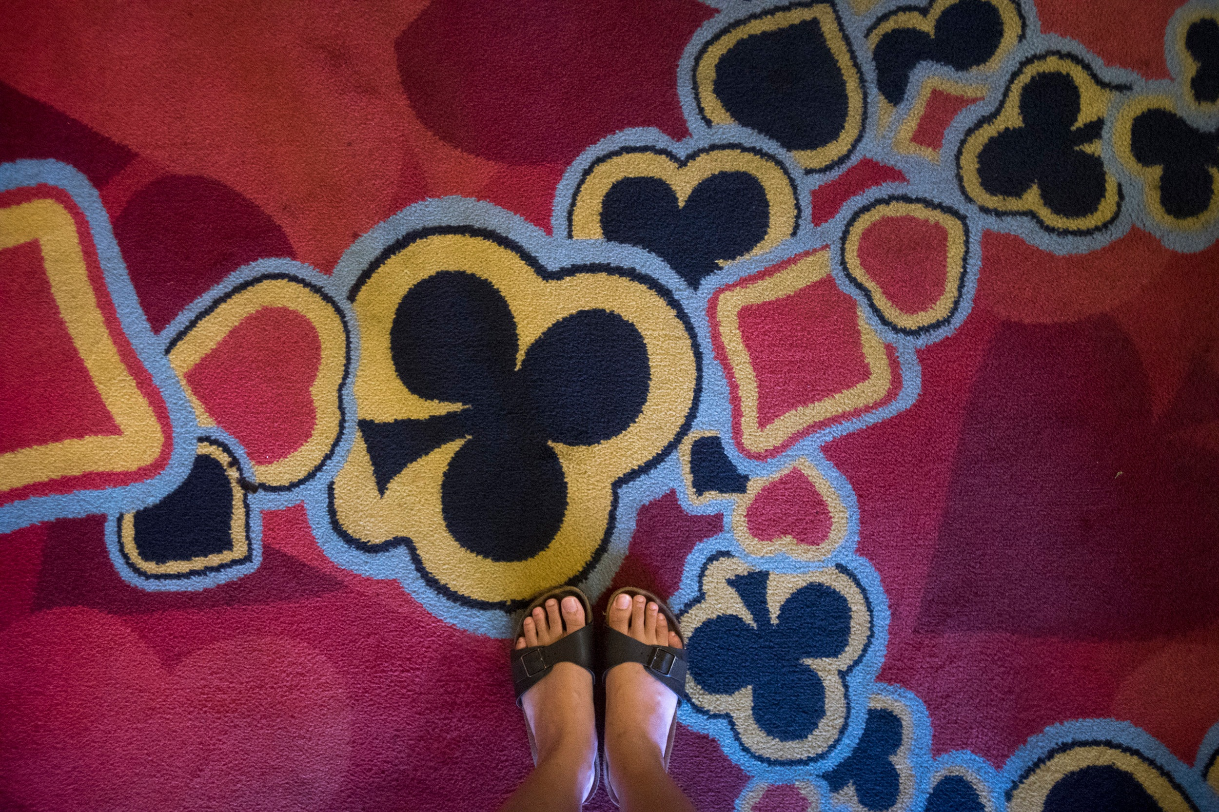 Gambling motifs adorn the carpeting of the M/V Amusement World, which was built in 1967, as pictured on March 15, 2018.