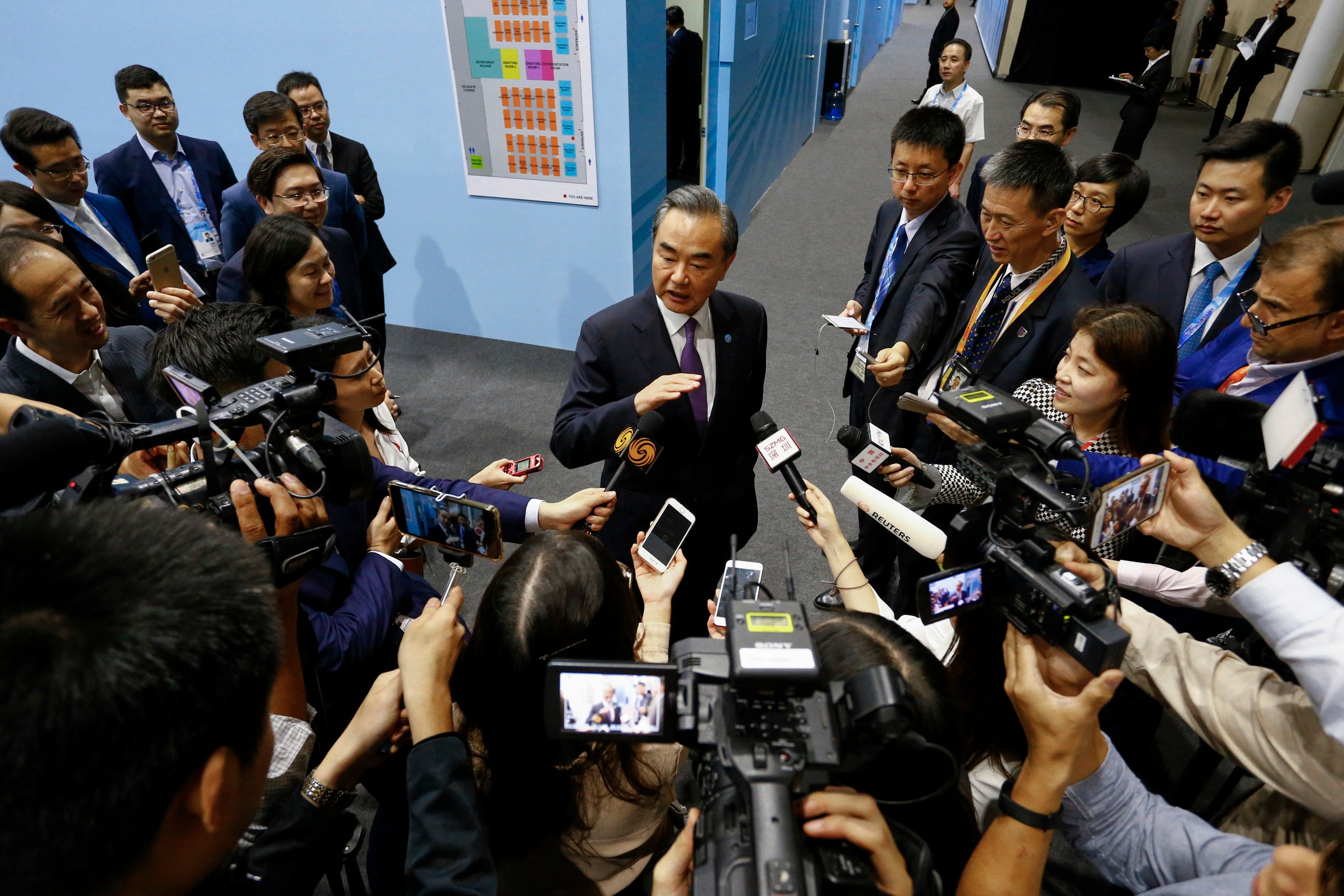 China's Foreign Minister Wang Yi speaks to reporters after a bilateral meeting on the sidelines of the ASEAN Foreign Ministers' Meeting in Singapore, August 3, 2018. REUTERS/Feline Lim