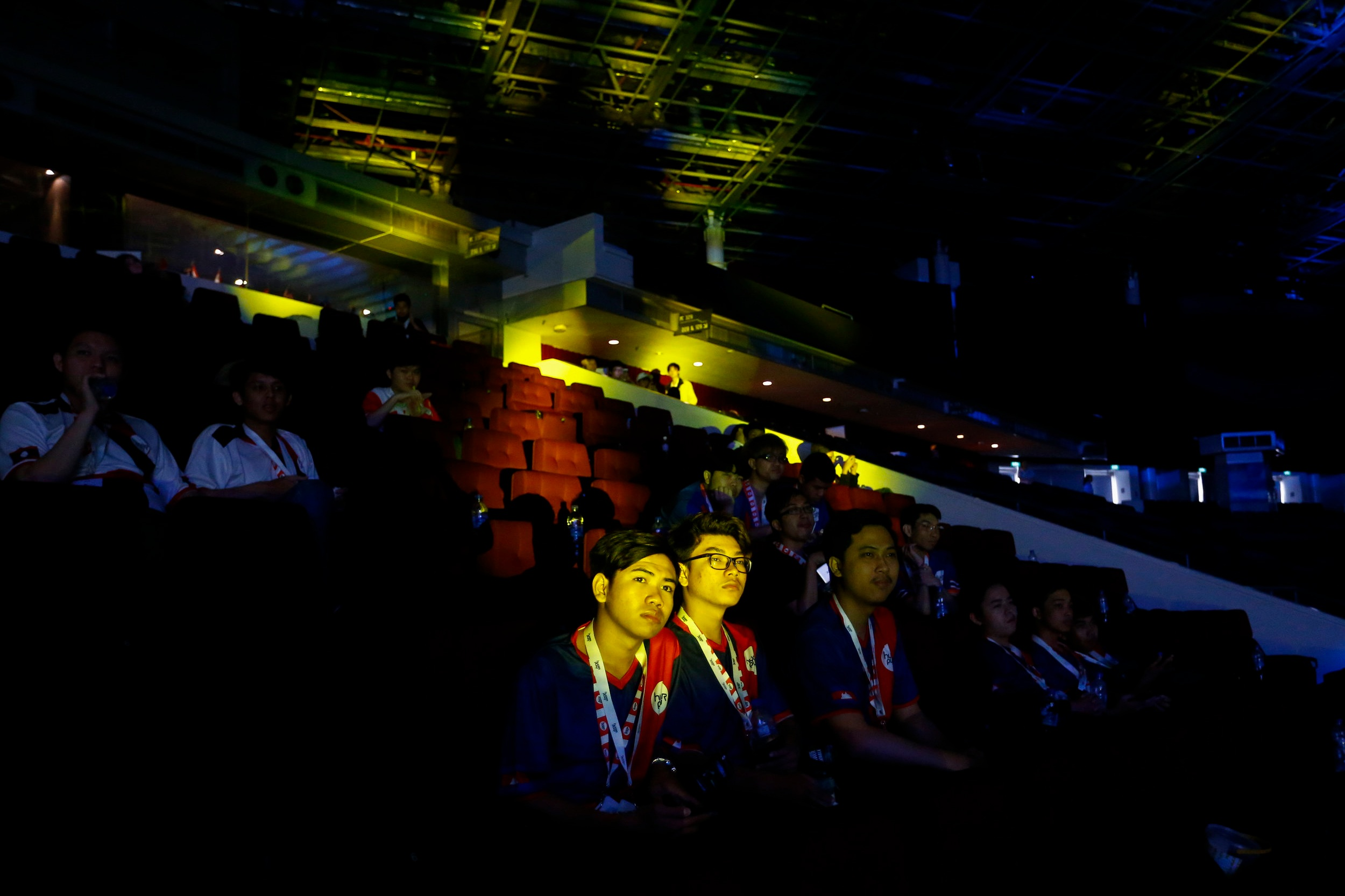 Cambodian League of Legends players watch Hyperplay, an e-sportstournament held in Singapore, August 4, 2018. REUTERS/FelineLim