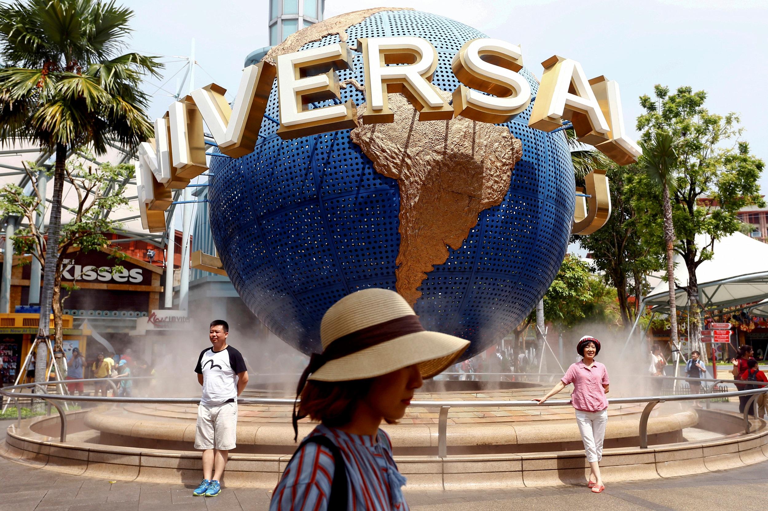 Tourists visit the Universal Studios in Sentosa, Singapore June 8, 2018. REUTERS/Feline Lim