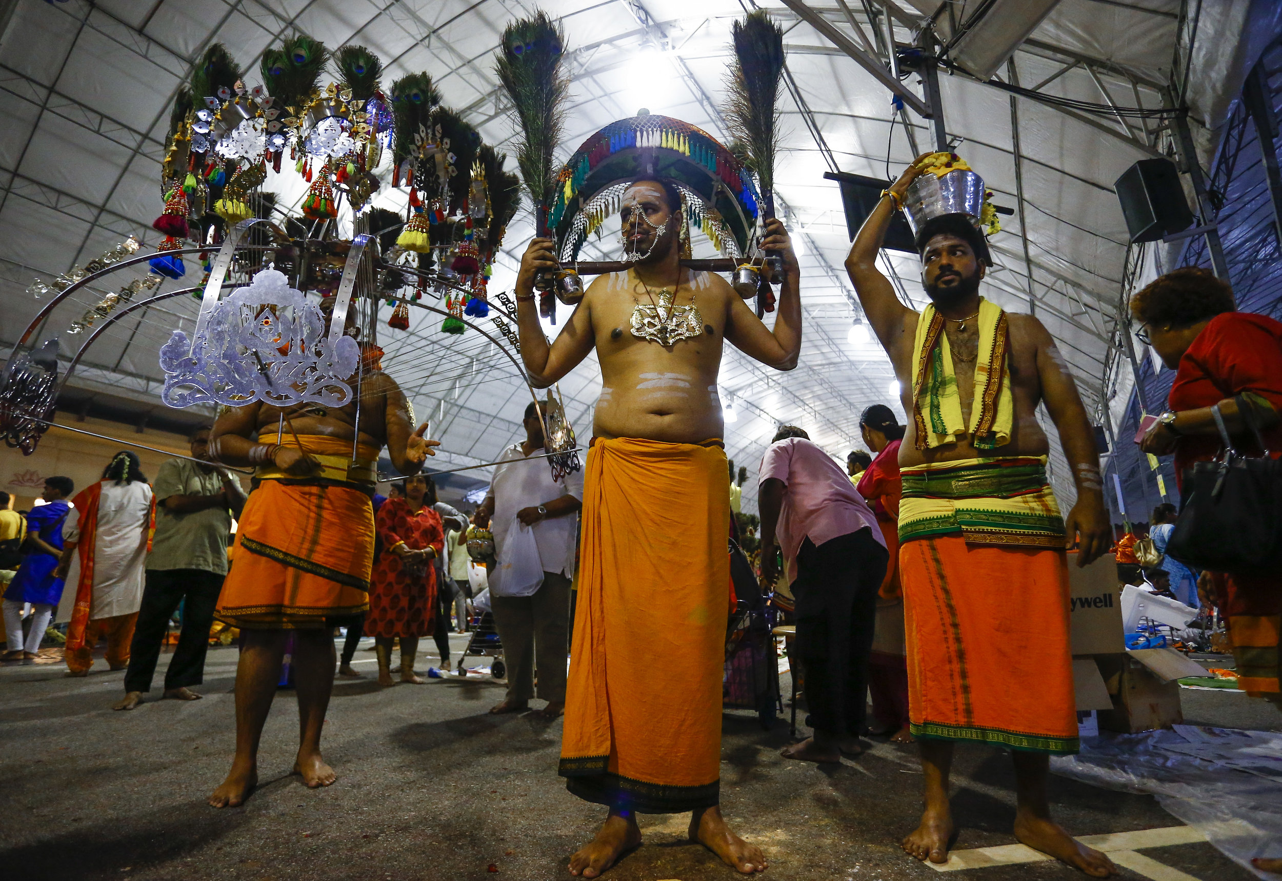 Devotees carrying various forms of kavadi are pictured during the Thaipusam festival in Singapore, January 21, 2019. Thaipusam is a Hindu festival observed on the day of the full moon during the Tamil calendar month of Thai, and celebrated in honour of the Hindu god Lord Murugan. REUTERS/Feline Lim