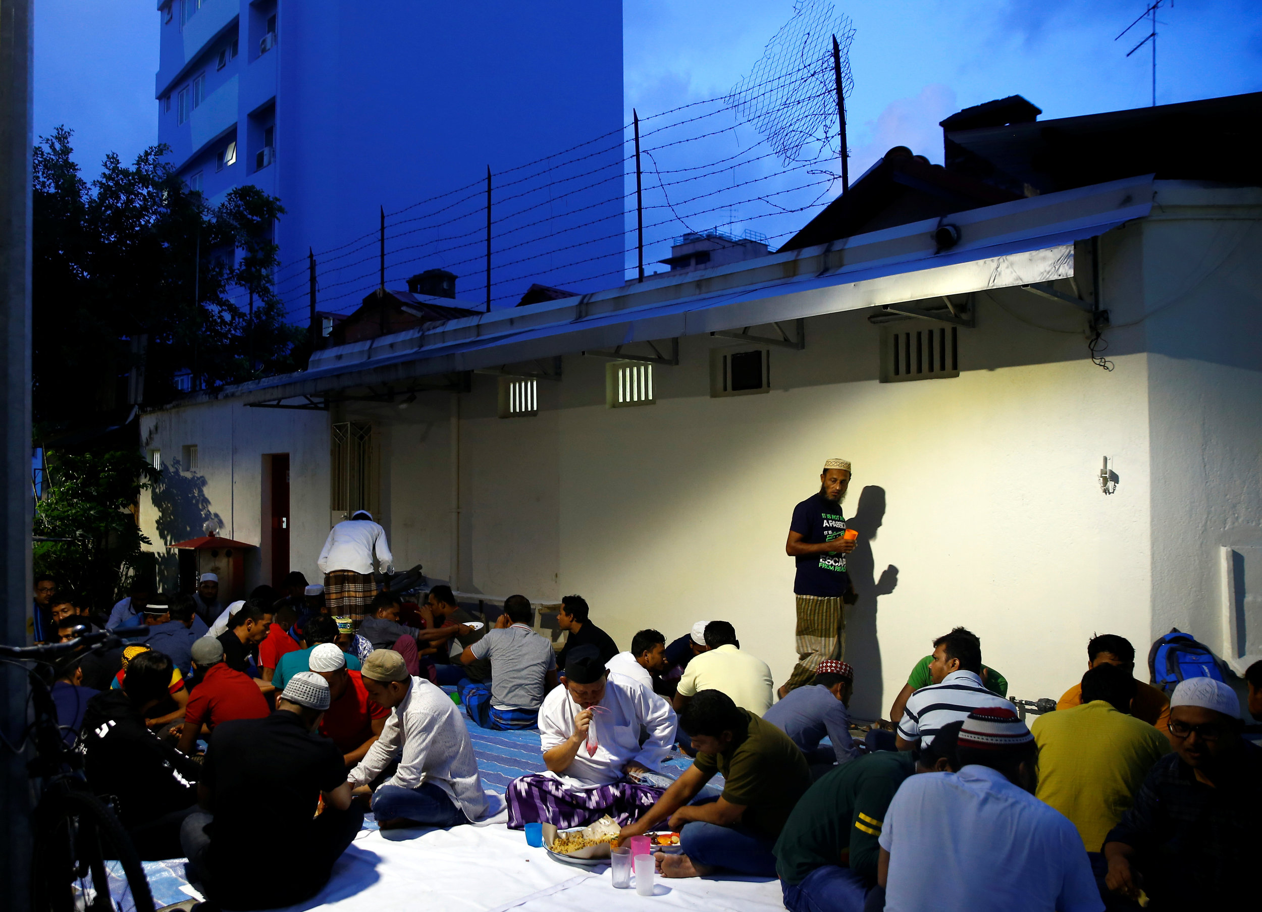 Bangladeshi migrant workers break fast during the holy fasting month of Ramadan at the Haji Mohd Salleh Mosque in Singapore, May 26, 2019. REUTERS/Feline Lim