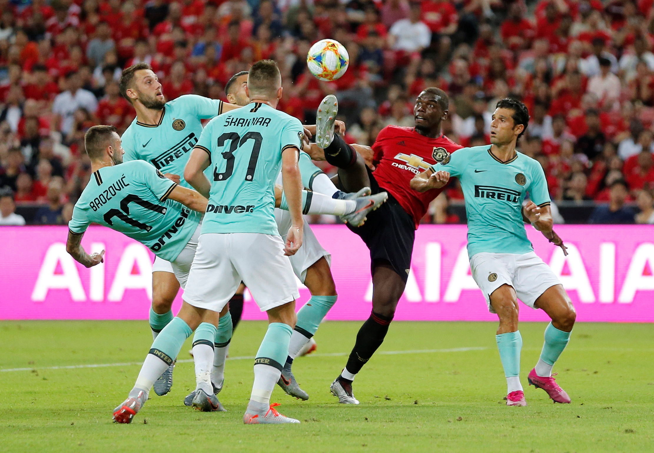 Manchester United's Paul Pogba in action with Inter Milan's Antonio Candreva and team mates during the International Champions Cup at the National Stadium in Singapore, July 20 2019. REUTERS/Feline Lim