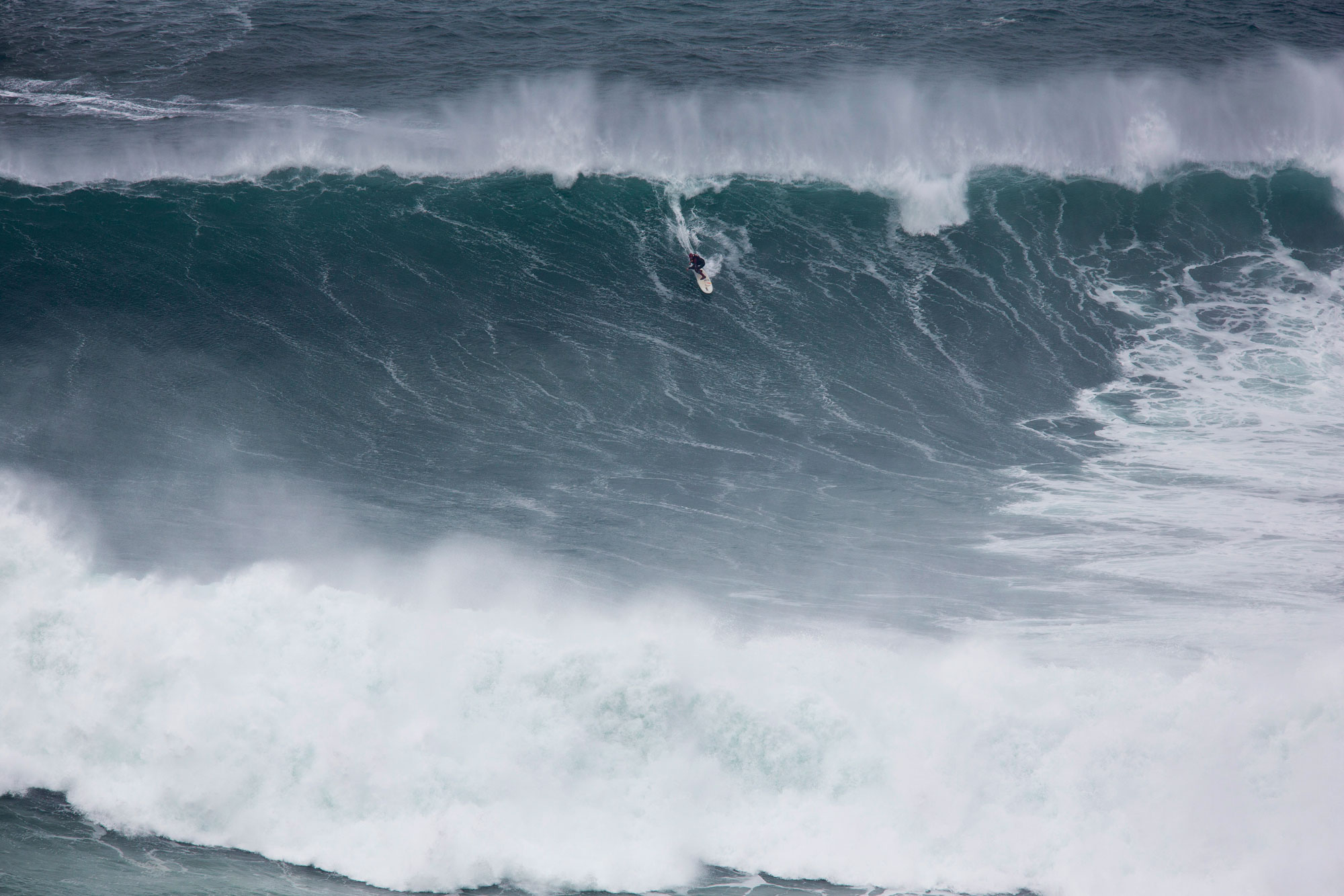 Big wave surfer Andrew Cotton in his element. Photography Vitor Estrelinha
