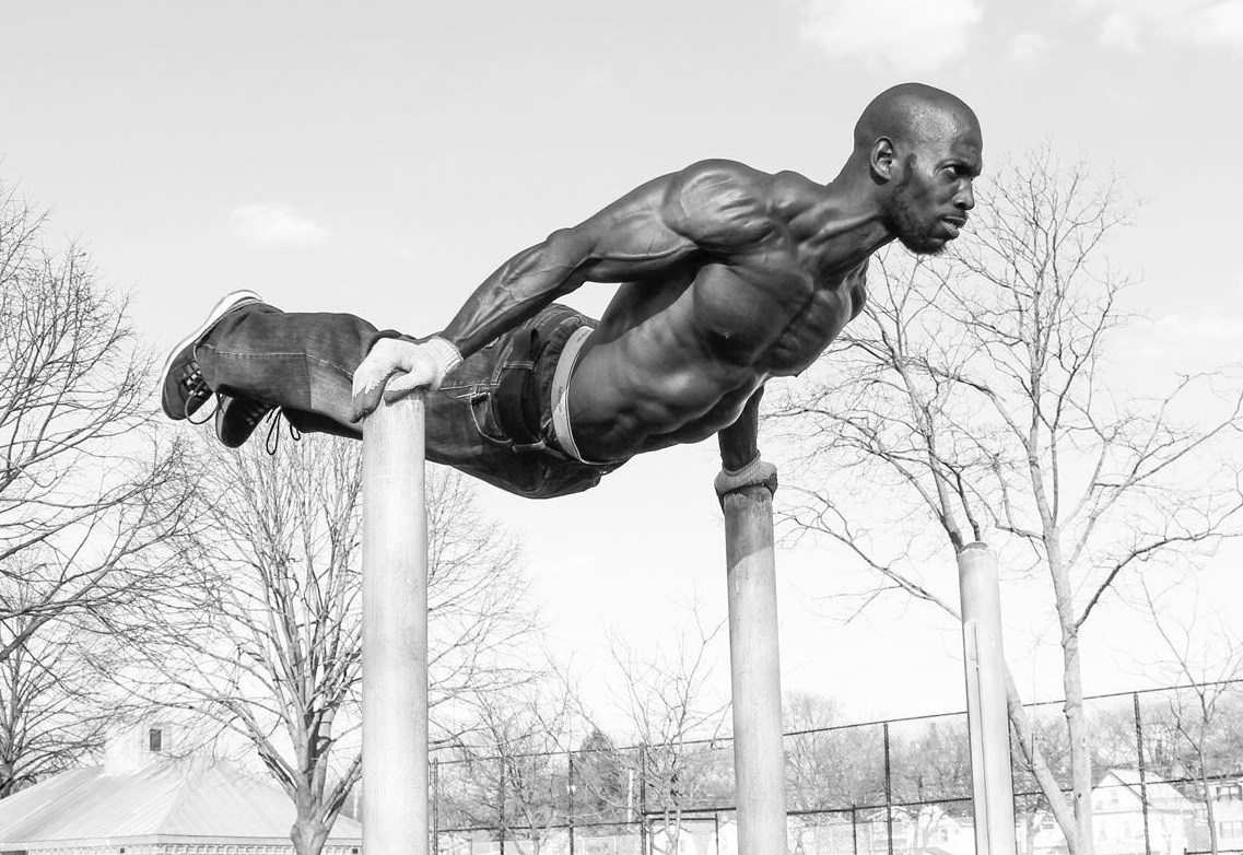 New York's Hannibal Langham performing an advanced calisthenics move: dip to back lever