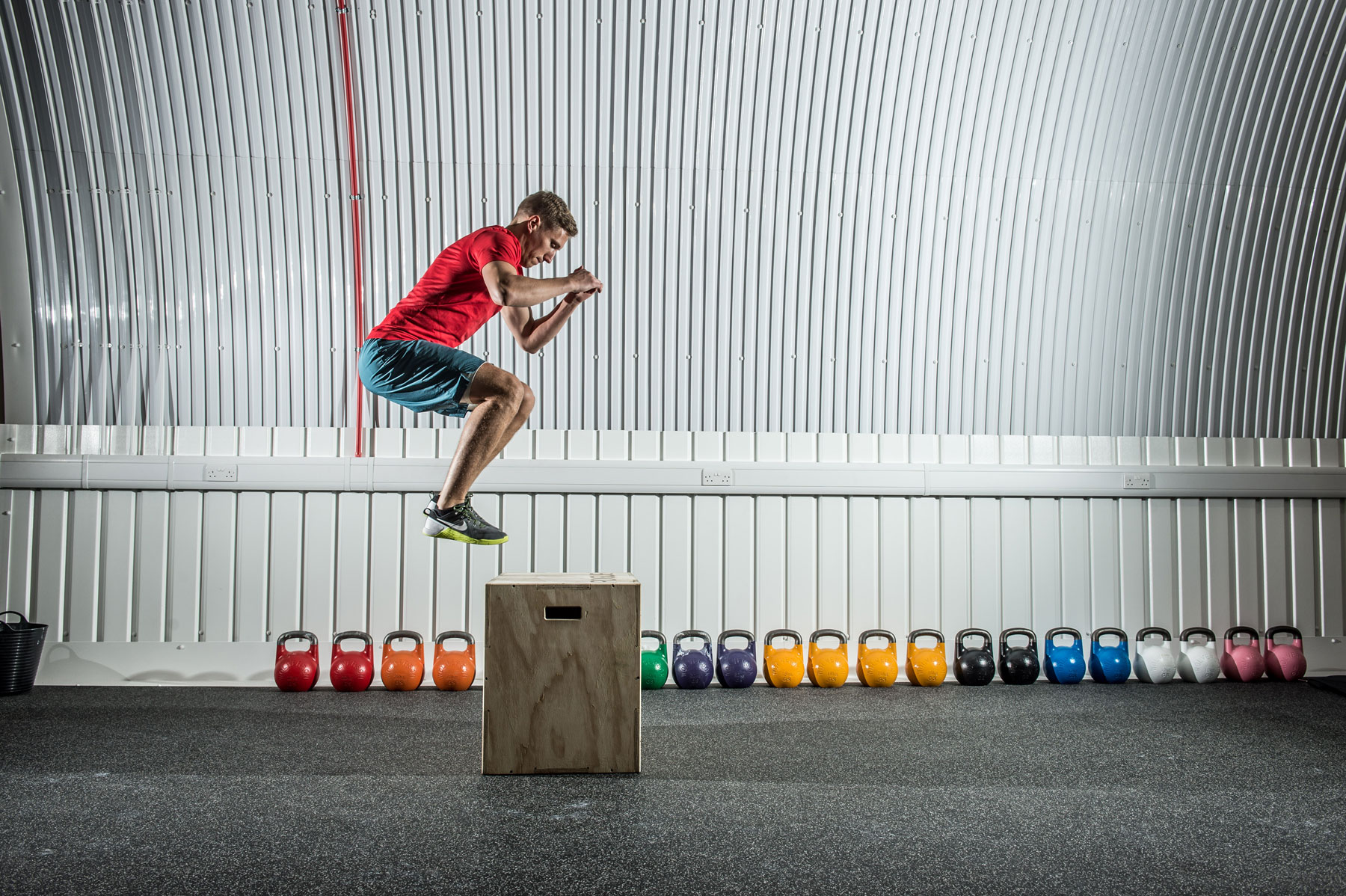 Action: metabolic conditioning circuits including box jumps are core to the 555 workouts.