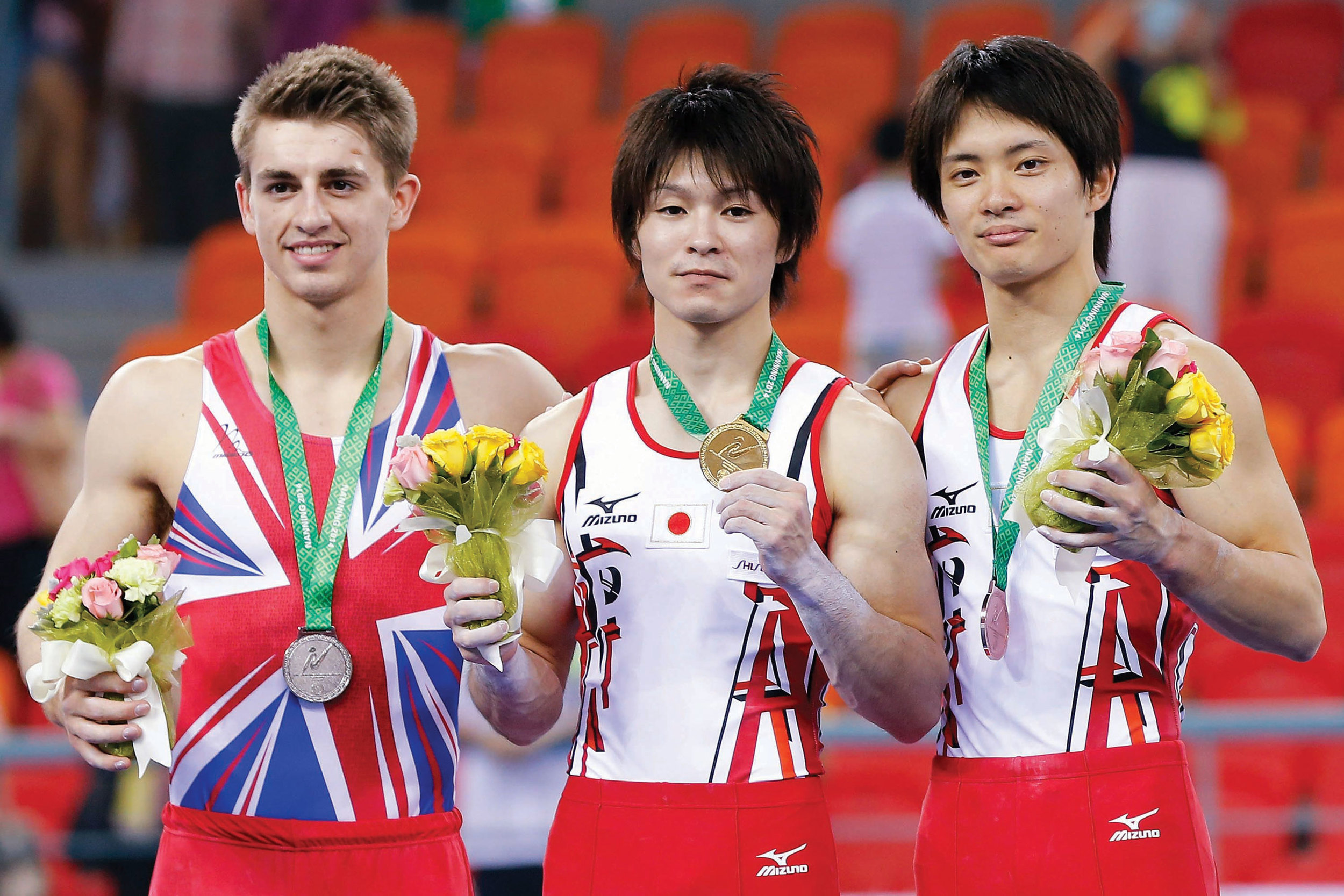 Silver lining: Whitlock (left) with his Olympic silver medal alongside Uchimura (centre) at London 2012.