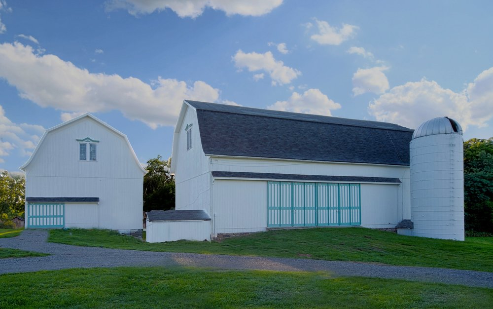 Phase 1 Renovations of Historic Wells Barns built 1898 Restored by Kane & Kristina Gascon 2016 Ceremony Barn (Left) & Reception Barn (Right)