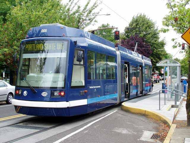 """Portland Streetcar station stop, with """"bulge-out"""" platform. Photo courtesy of Light Rail Now, Darrell Clarke, 2003."""