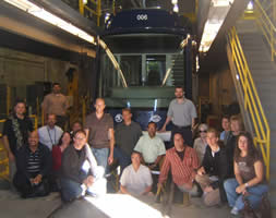 Tour participants in the streetcar maintenance pit  .