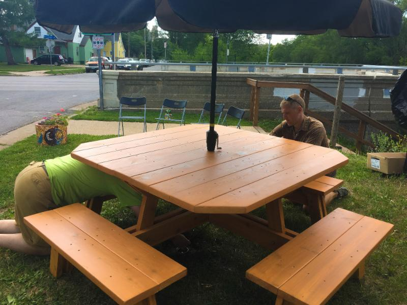 Assembling a picnic table at shared street parklet site