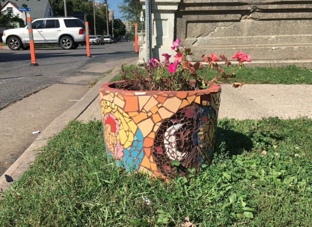 Flower planter created by the community at E. 29th St. & Bloomington Ave.