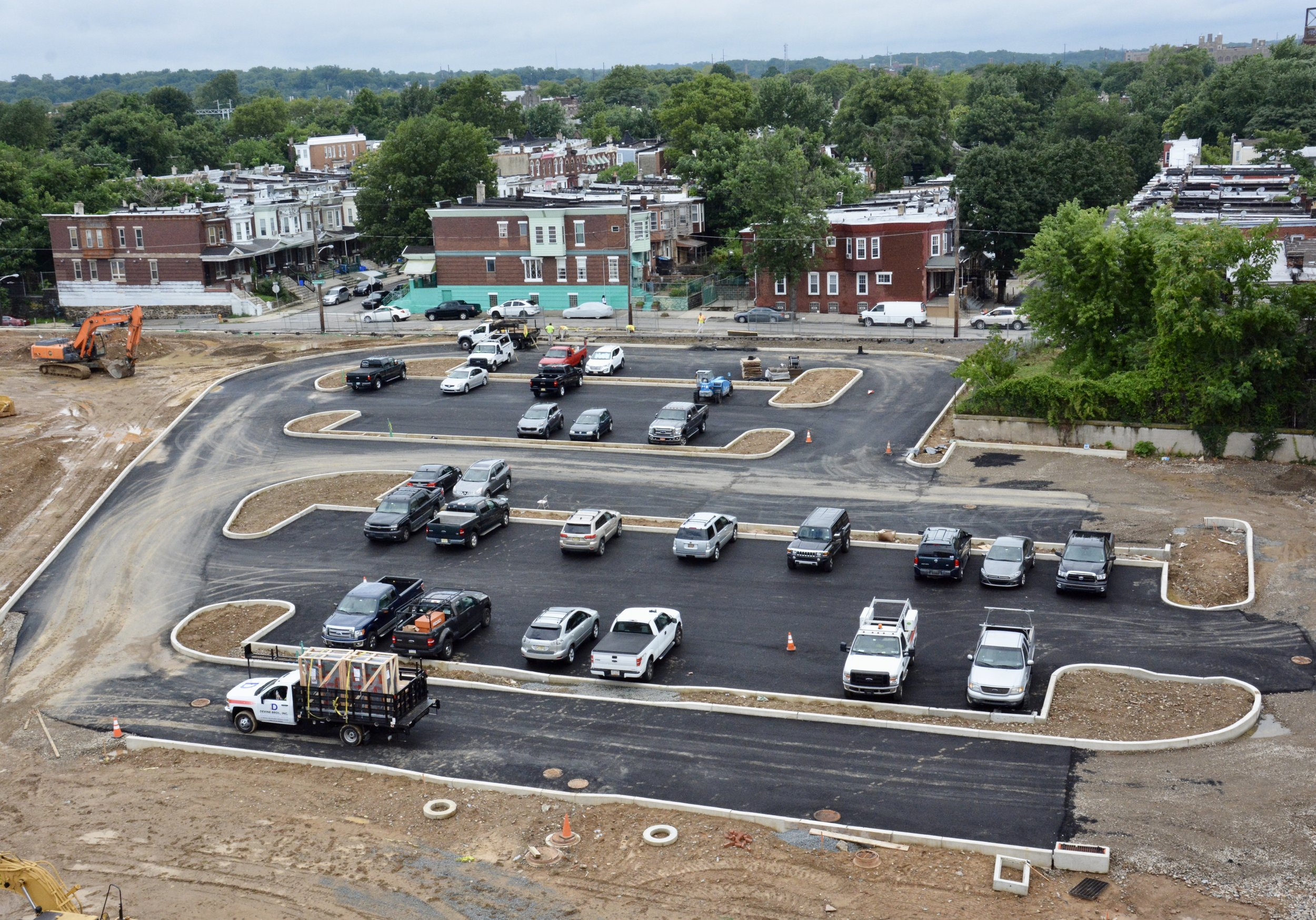 Aerial view of paved parking lot.