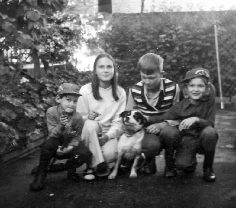 Angela (far right) with her siblings and dog Bingo.