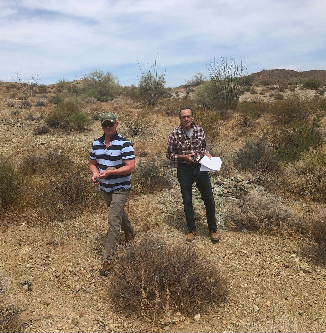Trangie Johnston (CEO) and John Petersen (consultant) inspecting outcropping mineralisation at the La Paz project