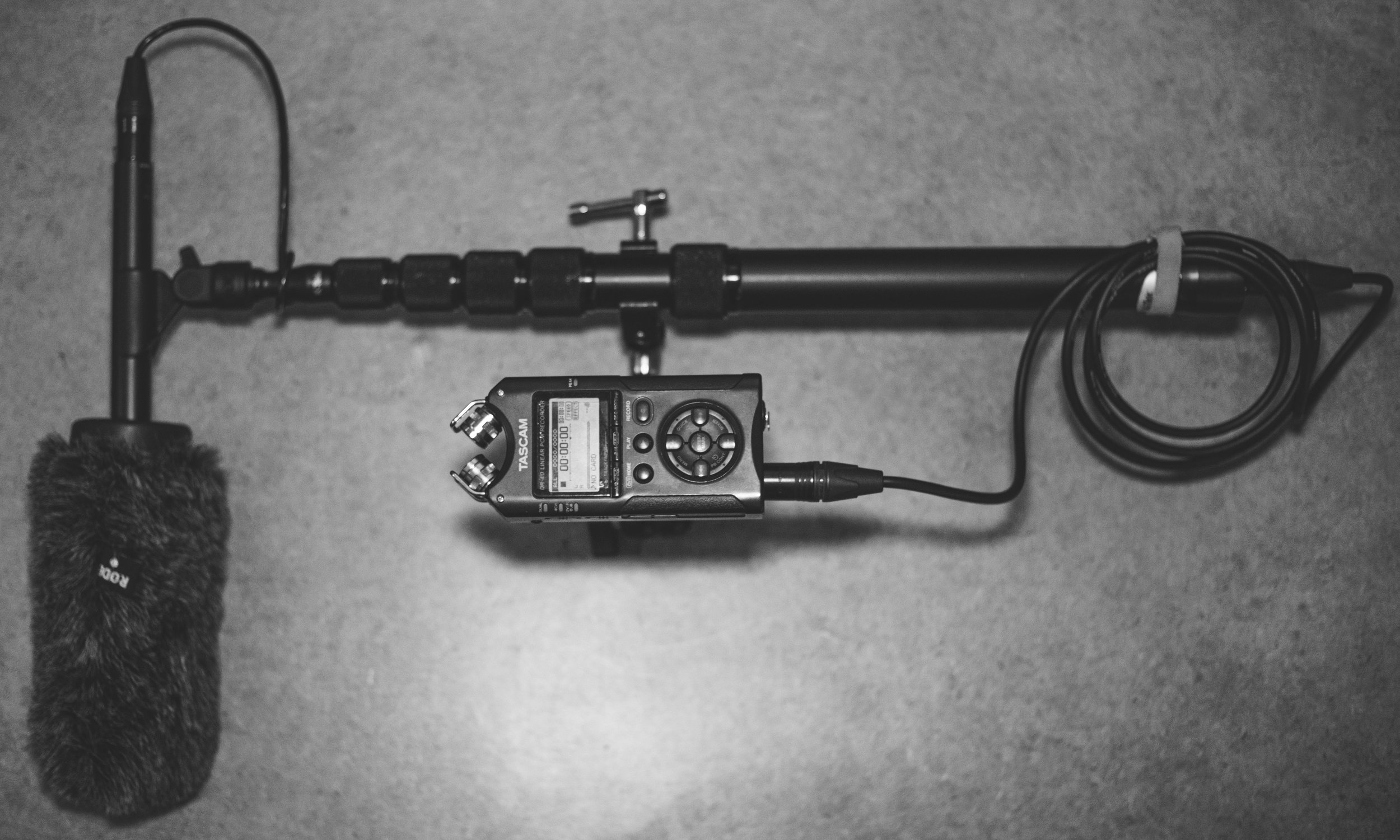 Above is an  NTG4+ Shotgun microphone ,  K-Tek Avalon Series Boom Pole , and a  Tascam DR-40  attached by a  GkGk Articulating Friction Magic Arm .