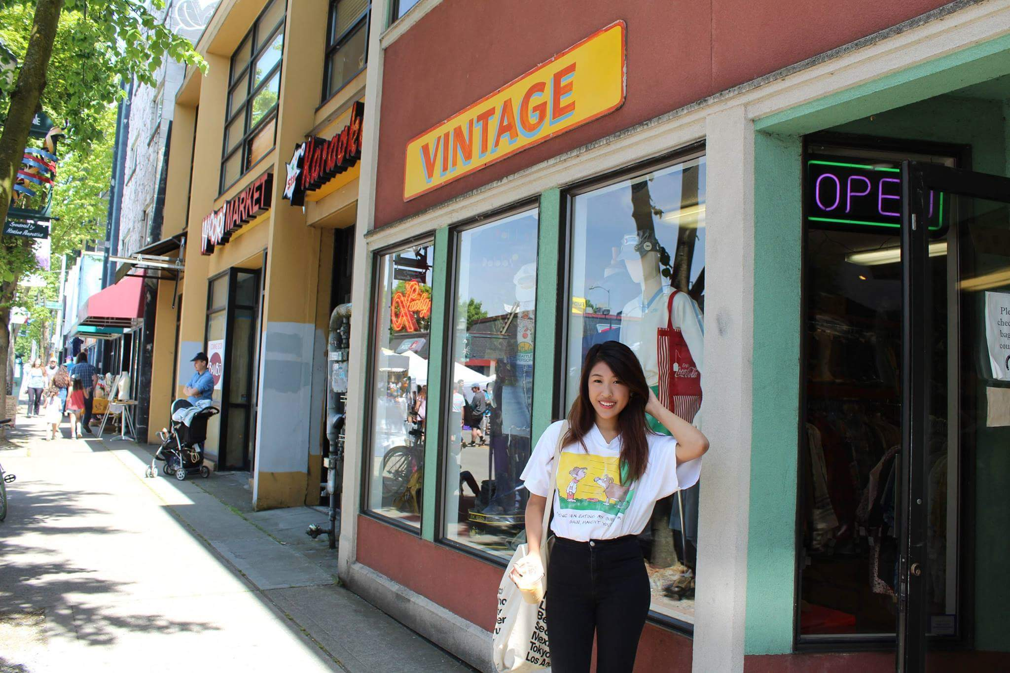 In front of a vintage store at the University village of University of Washington. We were sad that the cherry blossoms were no longer in season.
