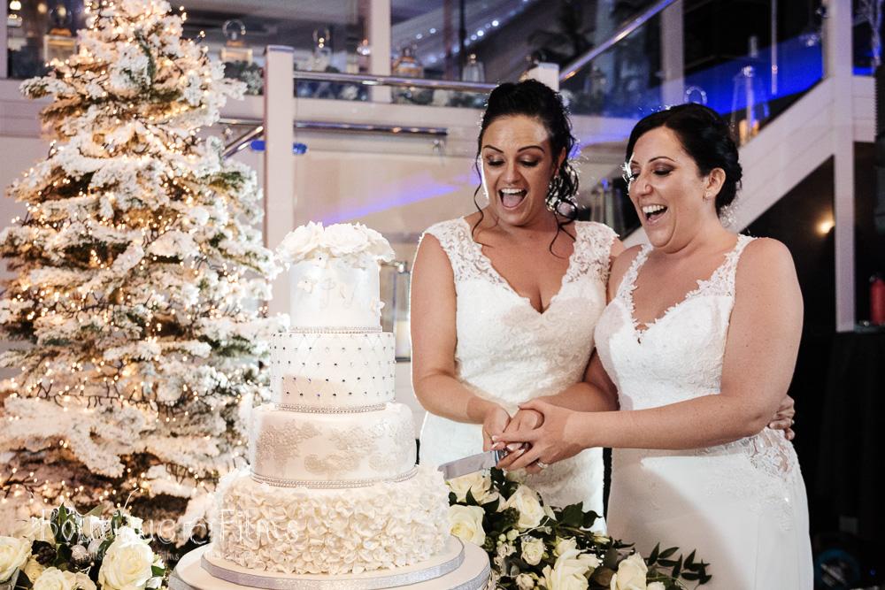 Jodie & Nicole Cutting Wedding Cake