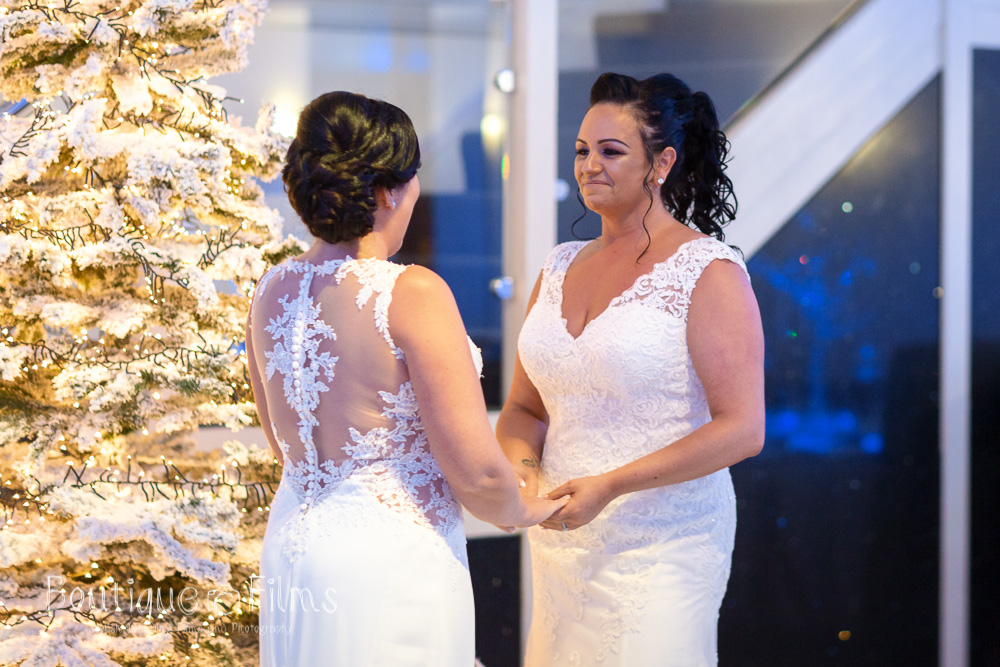 Jodie and Nicole next to their Christmas tree.  Photograph by Boutique Wedding Films & Photography