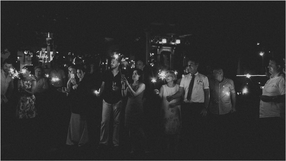 09 outdoor wedding party wedding photography night bokeh slovenia europe sparkler firework candlelight013.jpg