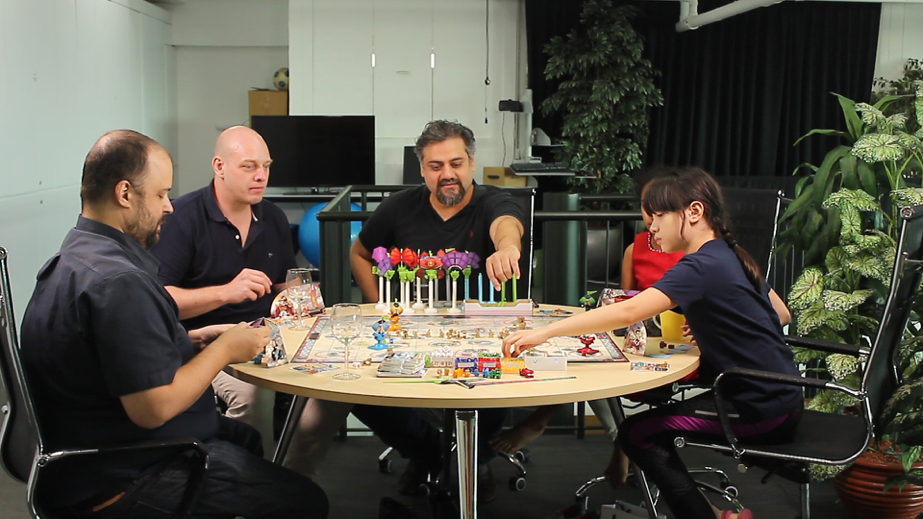 Adults and Children Play Avertigos Boardgame