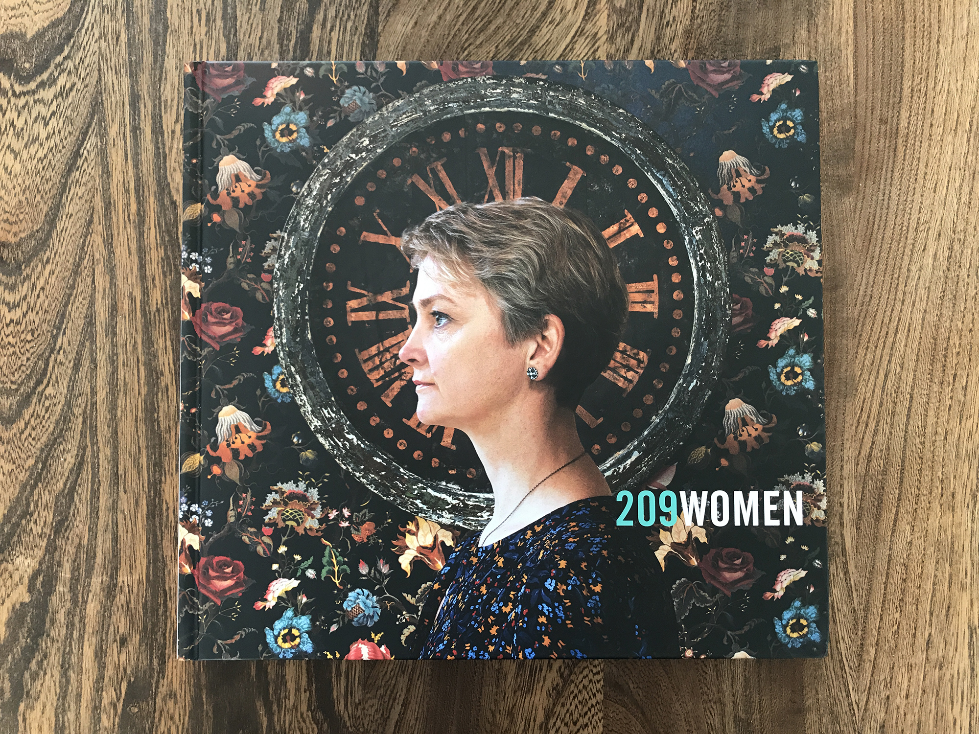 """(2019)   209 Women  , Bluecoat. (Cover Image: Yvette Cooper, MP for Normanton, Pontefract and Castleford,  Photographed by Hannah Starkey )  Curatorial Team: Hilary Wood, Tracy Marshall, Cheryl Newman, Lisa Tse.  Commissioned to create work for 209 Women:  """" 209 Women marks 100 years since the first general election in which some women could vote. It seeks to champion the visibility of women: particularly in politics, where decisions are made that affect people of all genders. It features new portraits of the UK's women MPs, shot entirely by photographers that identify as women""""   Delivered in partnership with the Open Eye Gallery, The Royal Photographic Society and The Sorority. It was funded by the Arts Council England, Liverpool City Council and the government's 'Women's Vote Centenary Fund'. It was sponsored by Aston Martin Lagonda, Power of Women series and Montessori St Nicholas and supported by Metro Imaging.   https://www.209women.co.uk"""