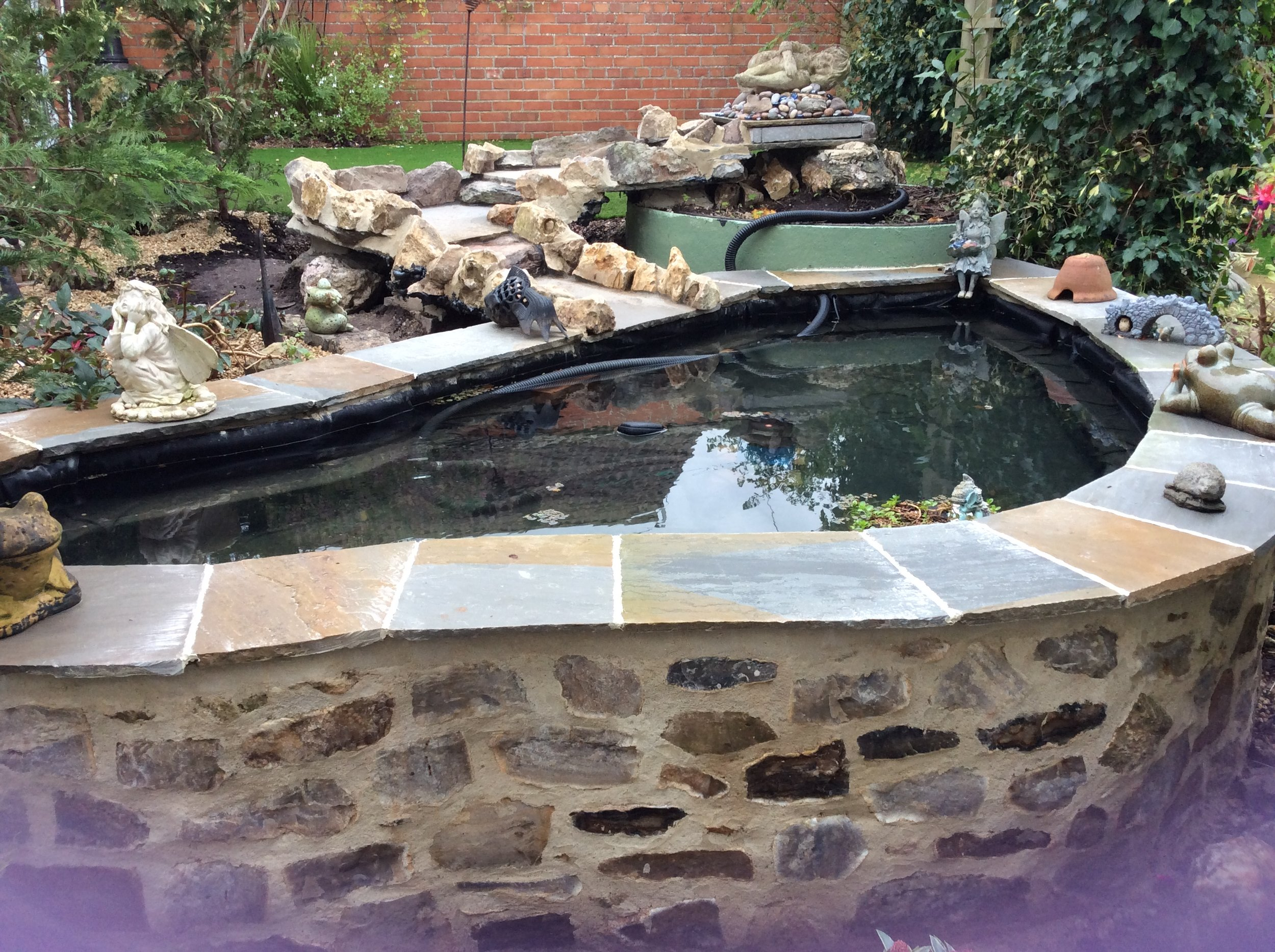 Before… - Pond wasn't quite finished how the clients wanted…