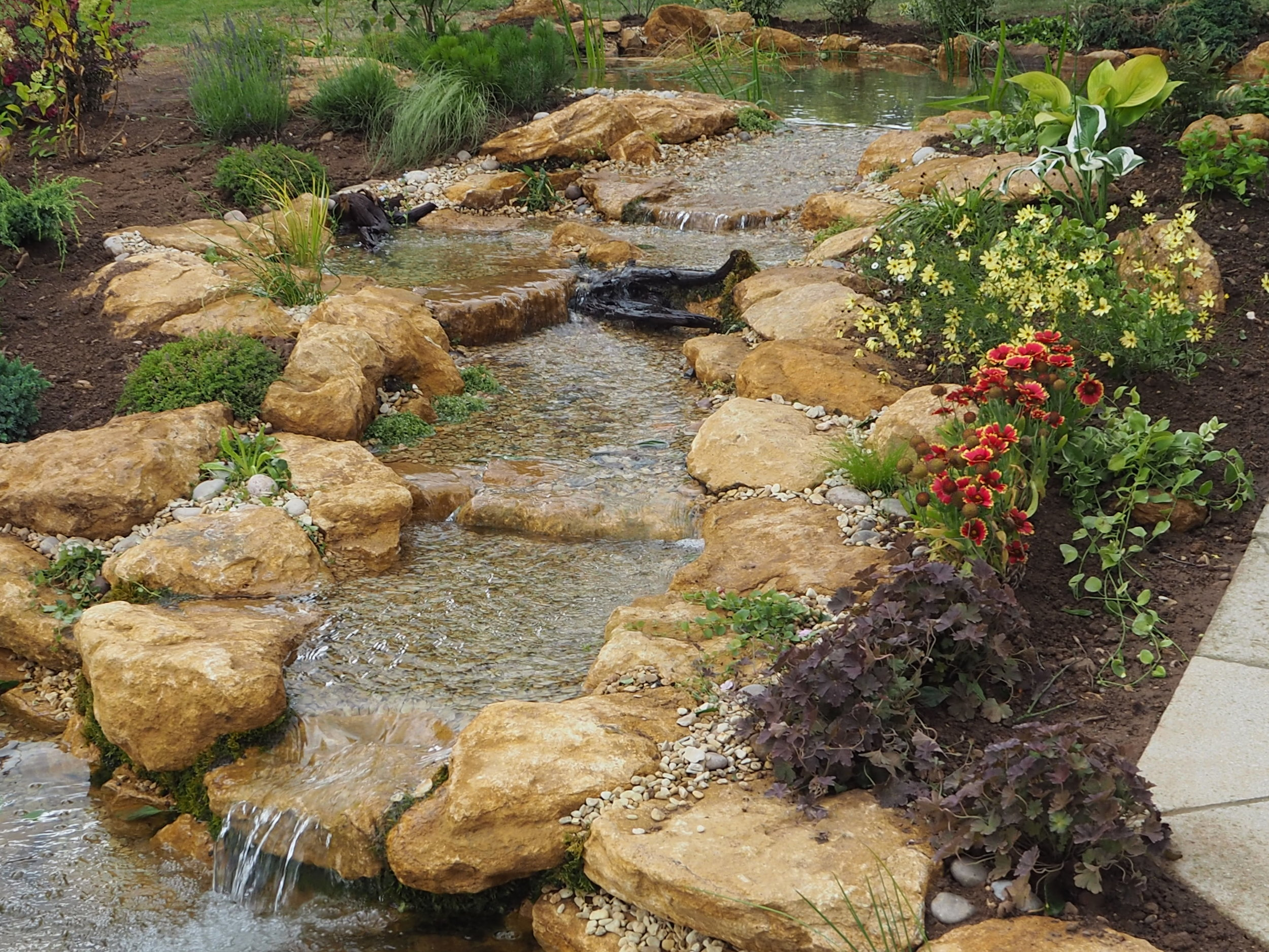 After… - Natural looking low profile stream and waterfalls