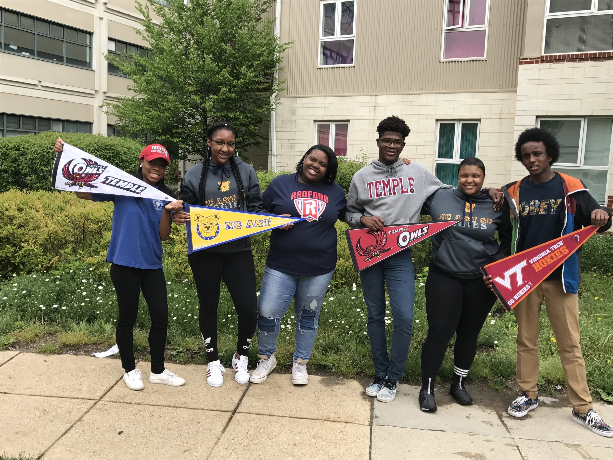 2017 grads with college pennants.jpg
