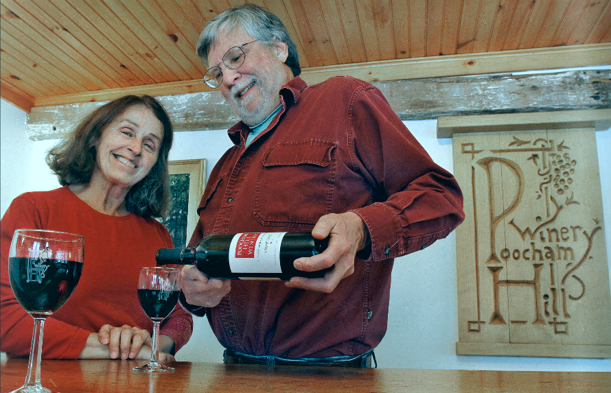Mame ODette and Steve Robbins pour from a bottle of their Frontenac 2014 in the tasting room at Poocham Hill Winery in Westmoreland. Photo by Michael Moore.
