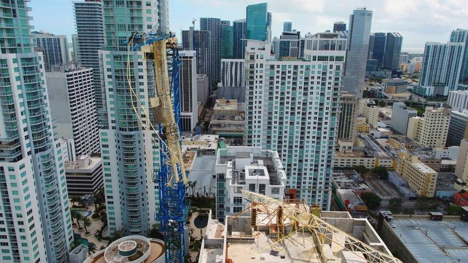 Condo development is booming in Miami. Hurricane Irma damaged this crane in a bay-front area filled with hotels and high-rise condo and office buildings near the AmericanAirlines Arena, where the NBA's Miami Heat plays.  Dronebase APy